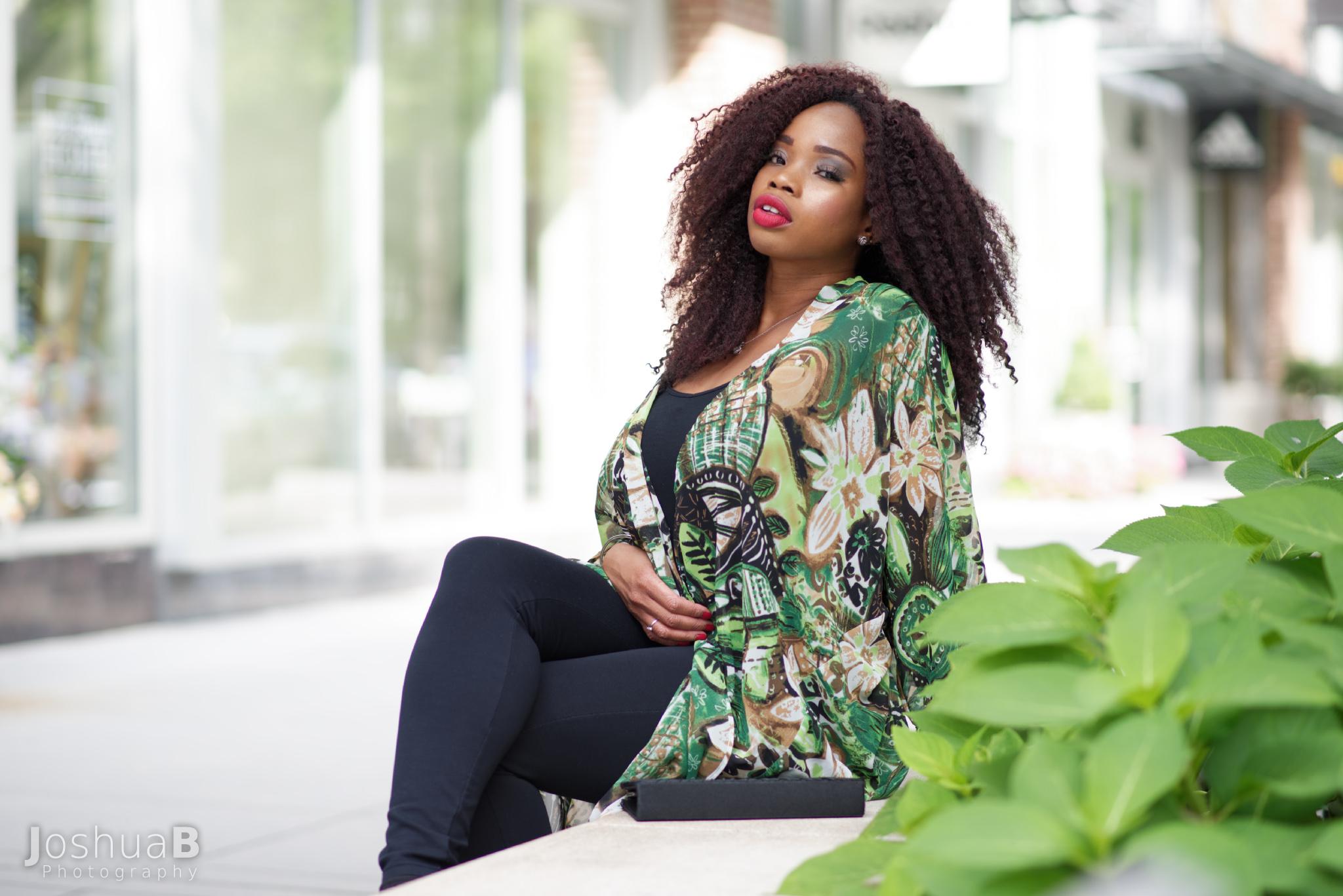 Beautiful black woman outdoor shopping plaza