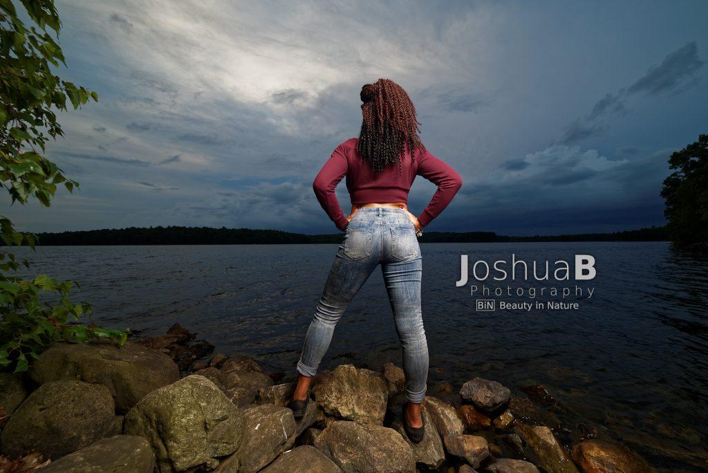 Beautiful black woman tight jeans facing lake