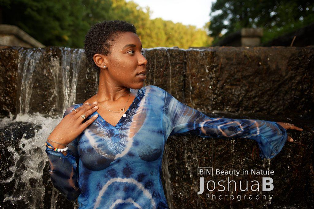 Black woman short hair wet dress waterfall