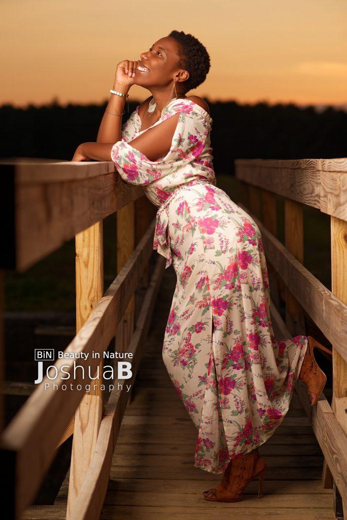 beautiful black woman short natural hair dress at sunset