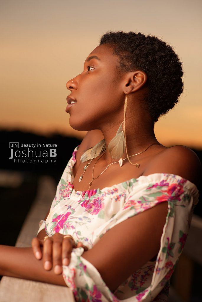 Beautiful black woman short hair dress sunset