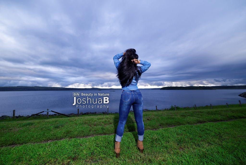 Latina long black hair denim facing lake