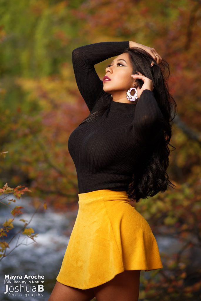Beautiful Latina yellow mini skirt fall foliage