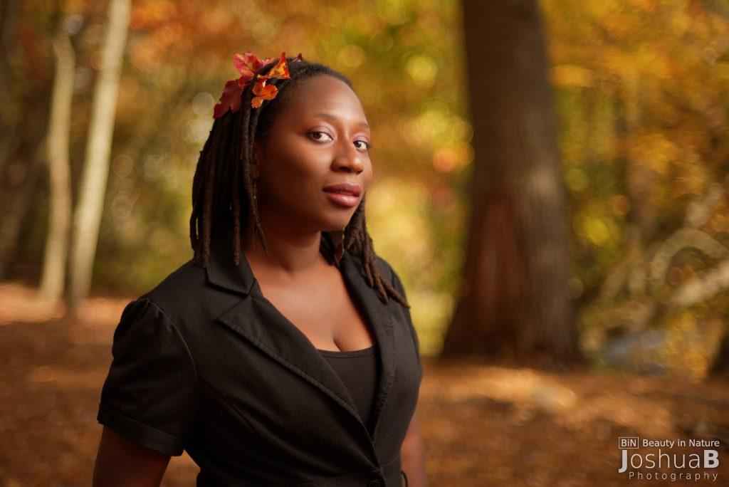 Beautiful black woman dreads fall foliage