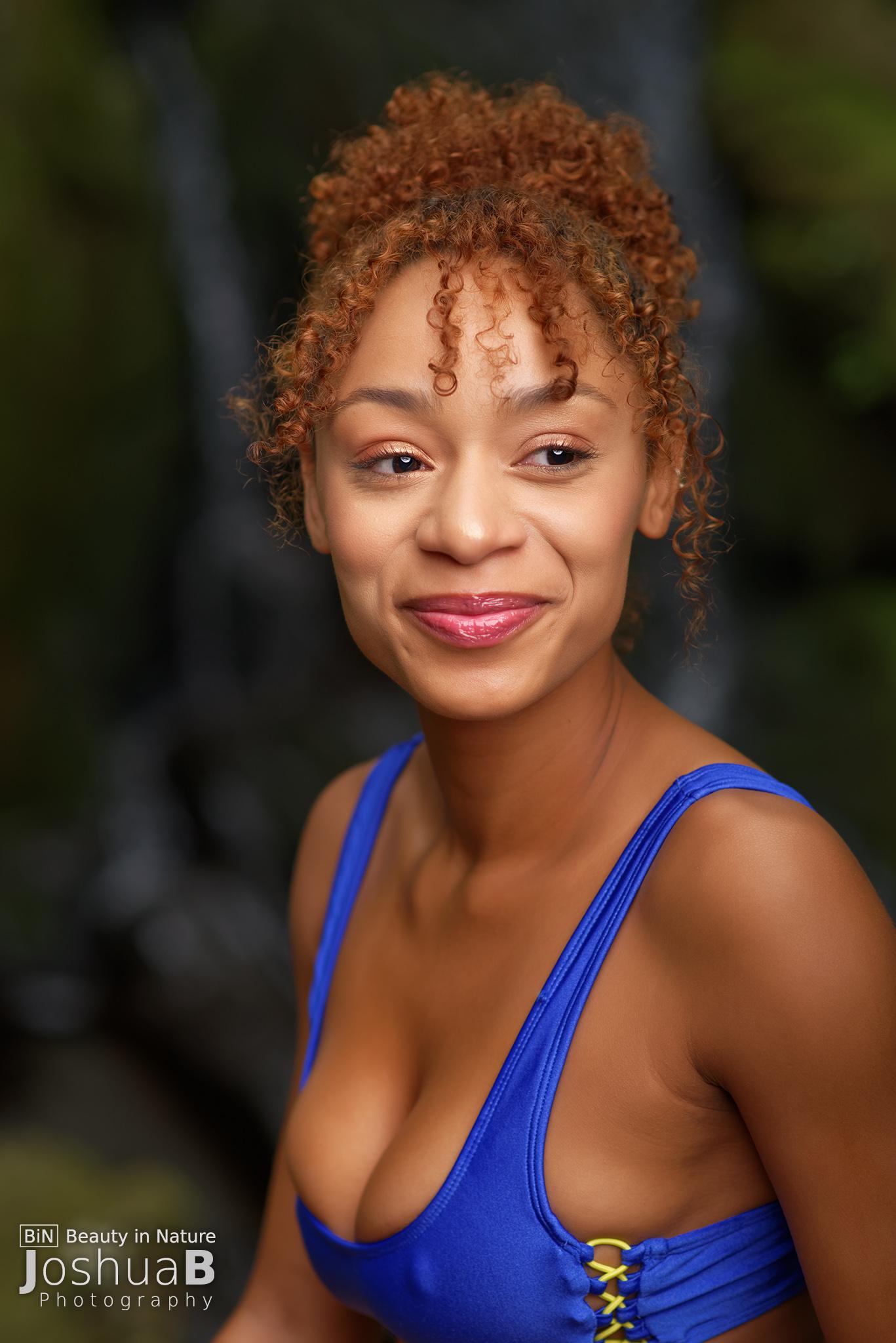 young woman headshot blue bikini