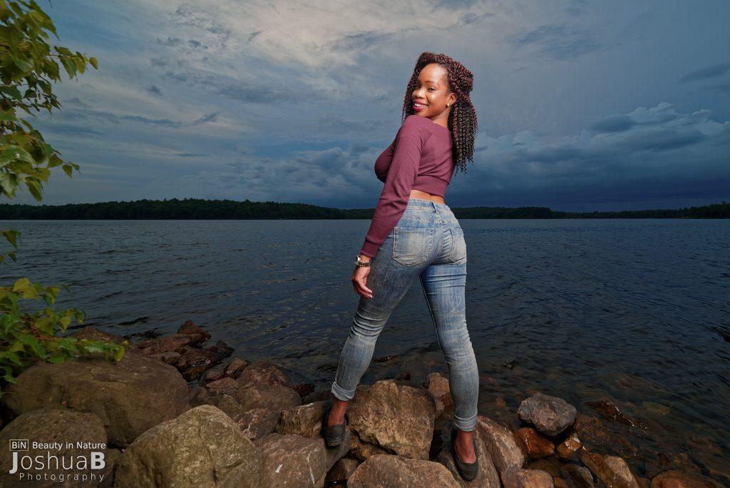 beautiful black woman jeans crop top lake
