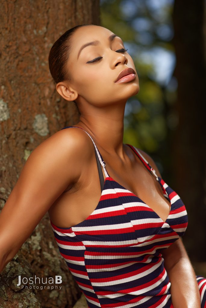 Beautiful Latina bust in red white & blue summer dress