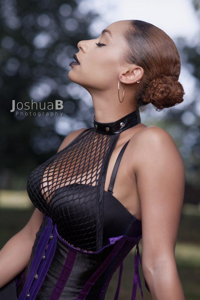 Beautiful Latina in corset and fishnet top Halloween cosplay