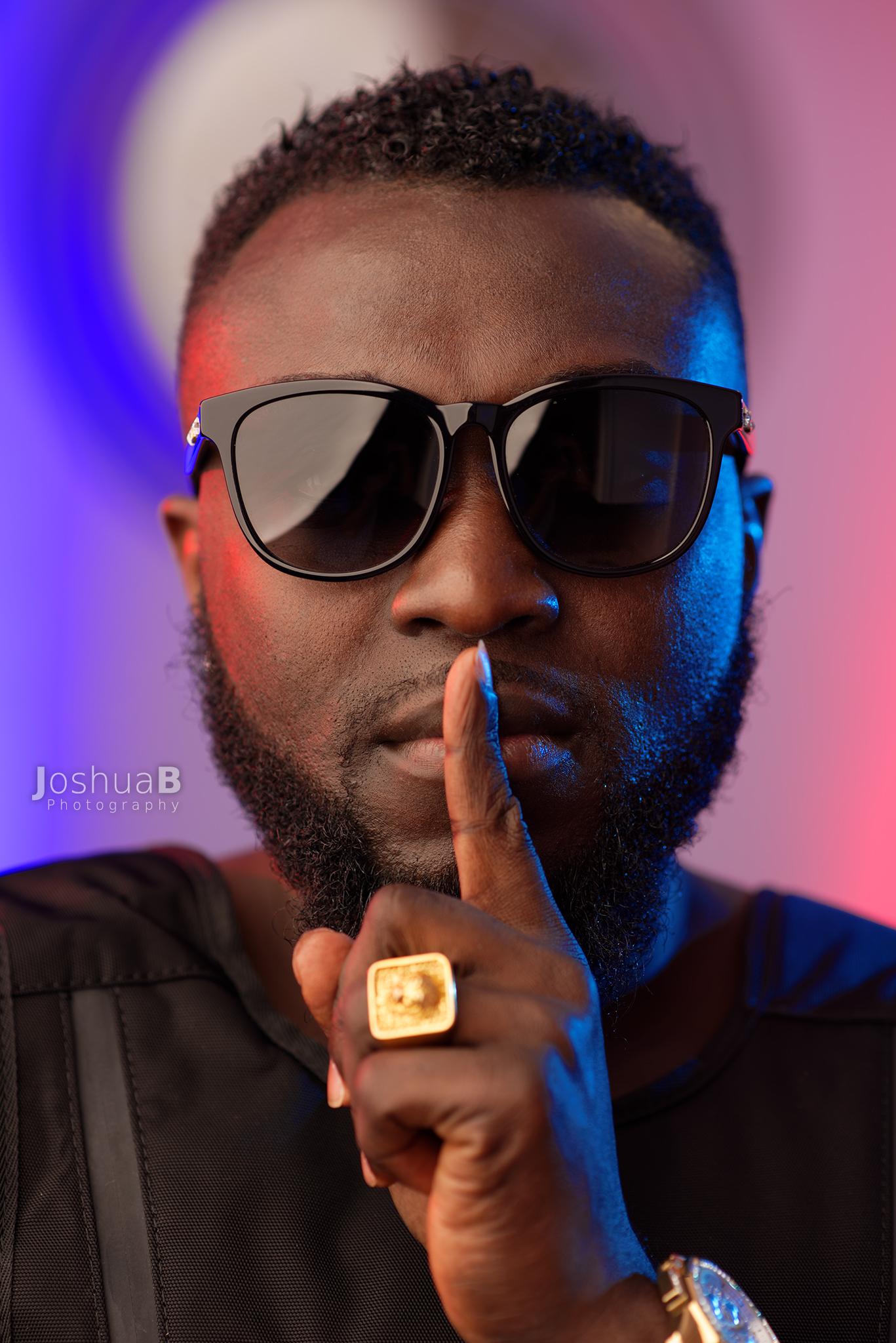 DJ Wyse in sunglasses in black