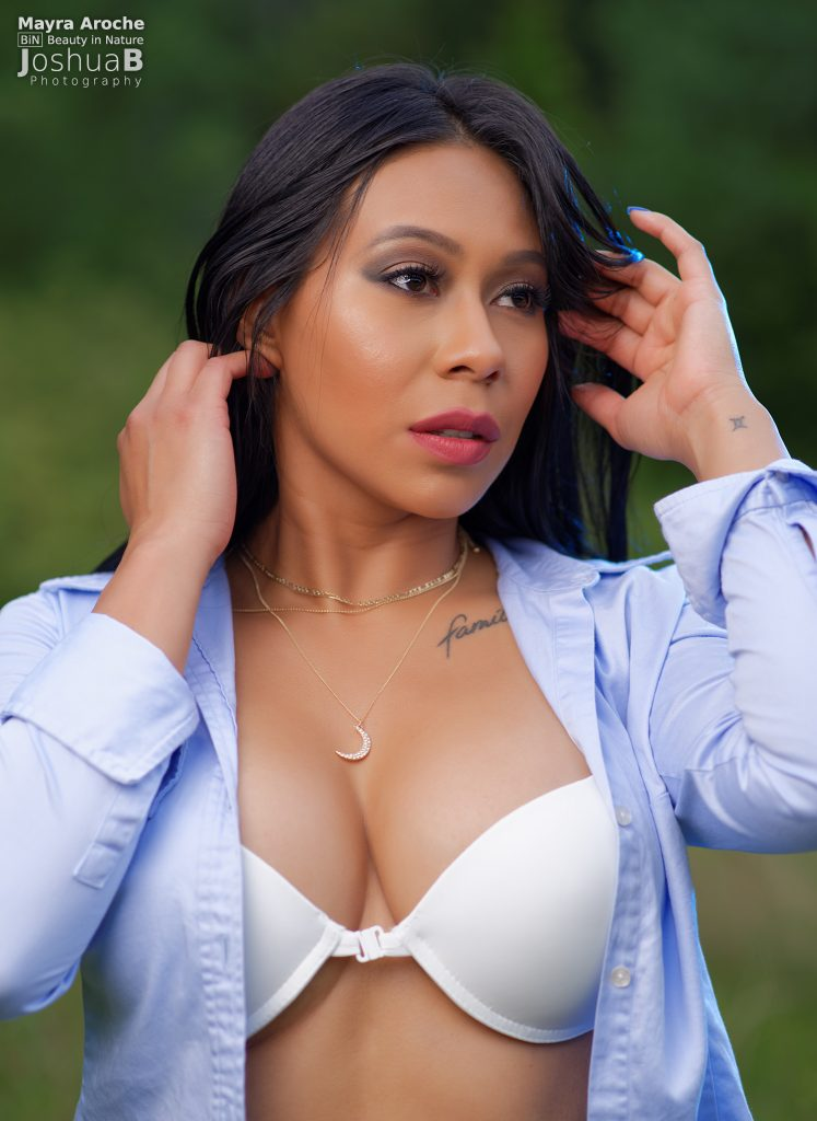 Mayra in blue oxford shirt and bra